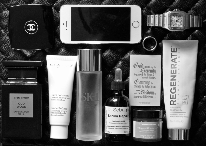 selection of beauty products and daily essentials shot in black and white
