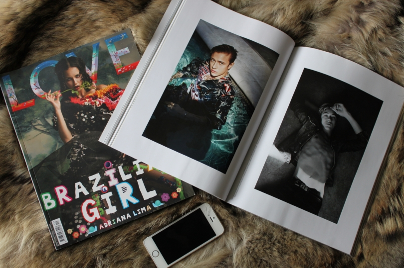 magazines and an iPhone on a coyote fur blanket