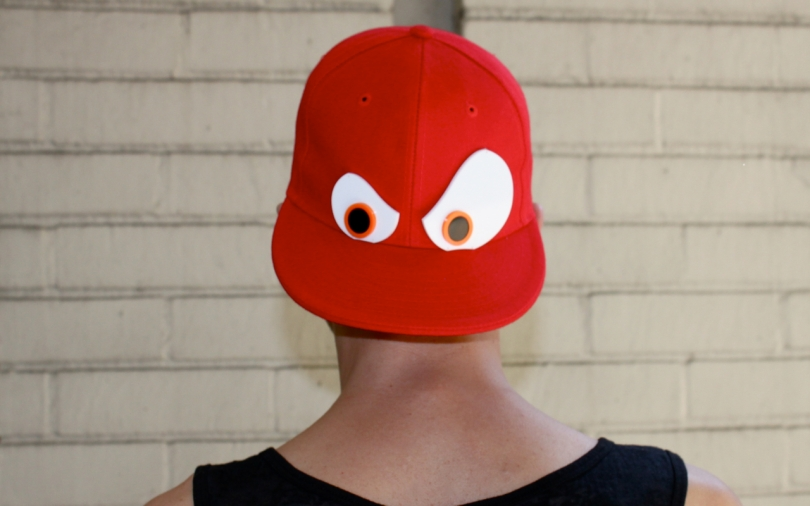 red Piers Atkinson baseball cap with eyes on the back viewed from behind