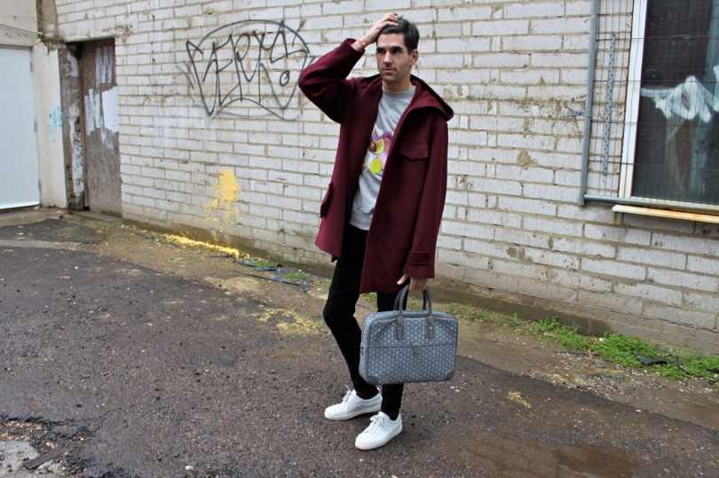 me in a dingy street wearing a burgundy cashmere parka and grey goyard bag