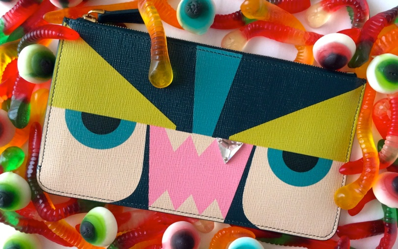 fendi monster face pouch surrounded by gummy candy