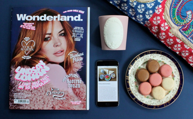 flatly featuring wonderland magazine with lindsay lohan on cover plate of macaroons and laduree pink candle