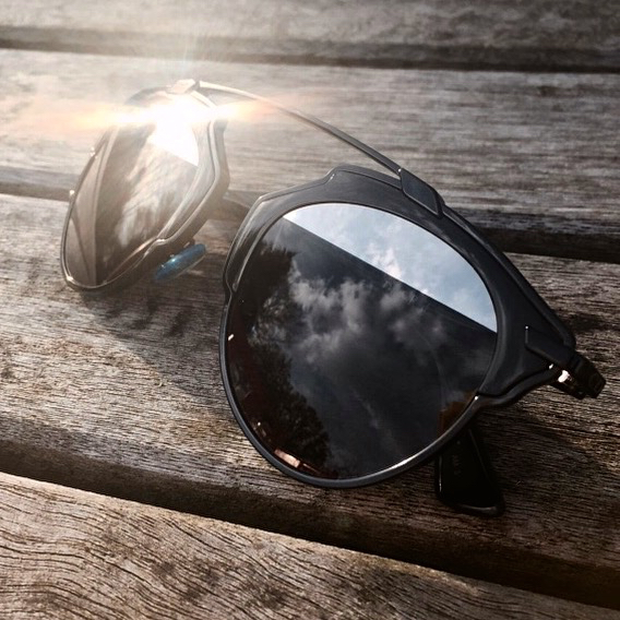 black dior so real sunglasses with mirror detail gleaming in the sun