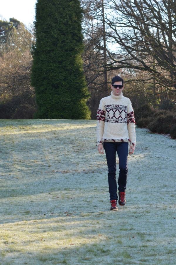 walking through a frosty garden wearing isabel marant jumper acne jeans fracap boots and celine sunglasses