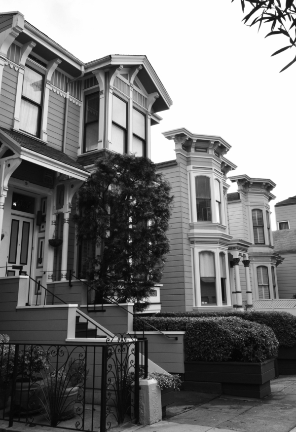 black and white shot of traditional victorian san francisco houses