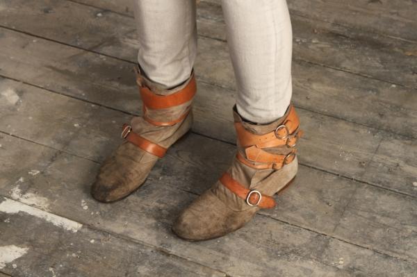 vintage vivienne westwood pirate boots against an old wood floor