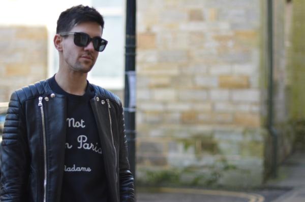 head and shoulders shot wearing black balmain biker jacket and tom ford sunglasses