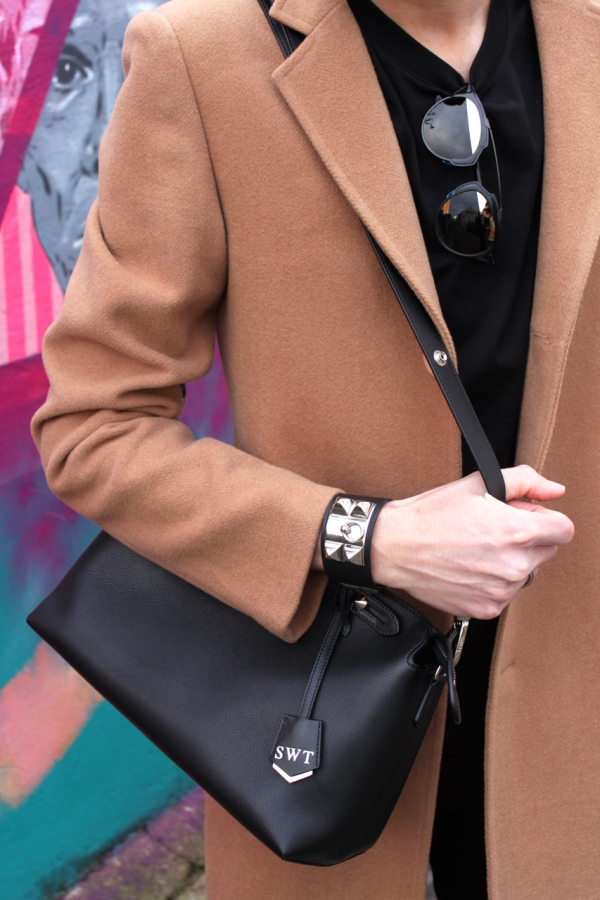 detail shot of hermes CDC cuff dior so real sunglasses and fendi by the way black bag worn with camel coat