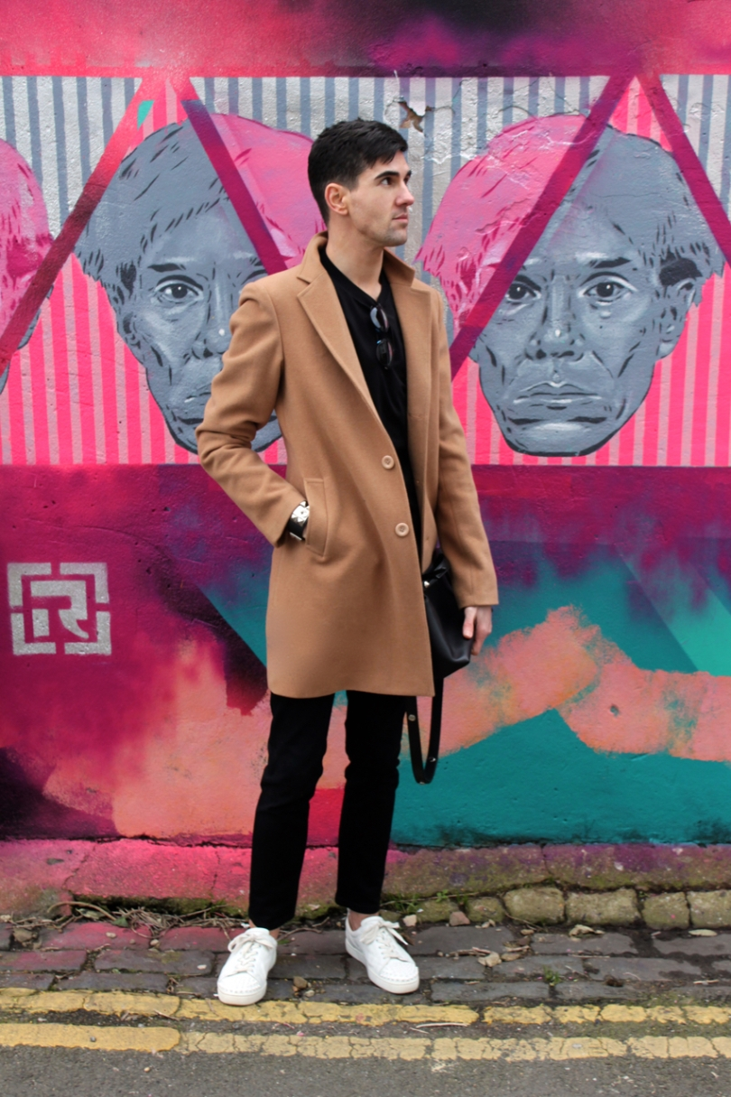 street style shot in brighton wearing black outfit and camel coat