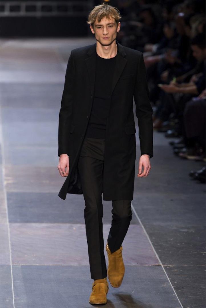saint laurent paris suede boots with an all black ensemble