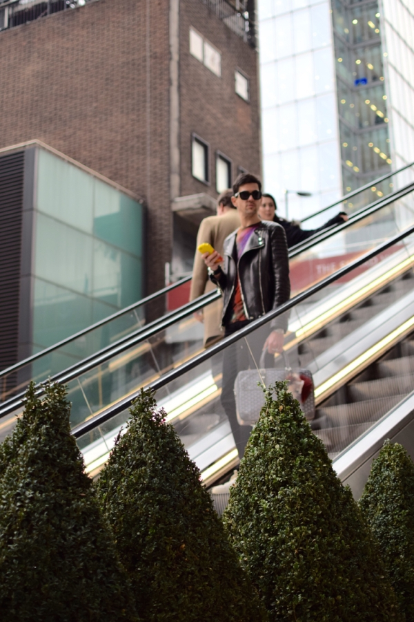 looking sideways on escalator in London