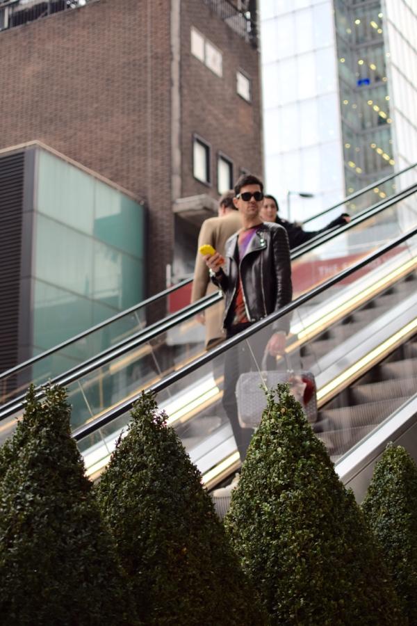 looking sideways on escalator in London