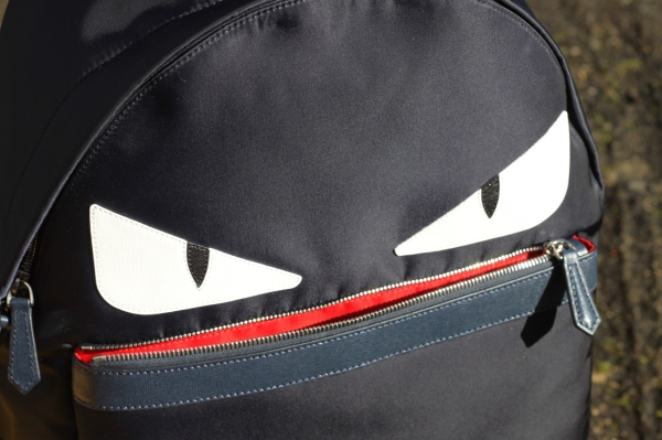 navy Fendi monster backpack with mouth open