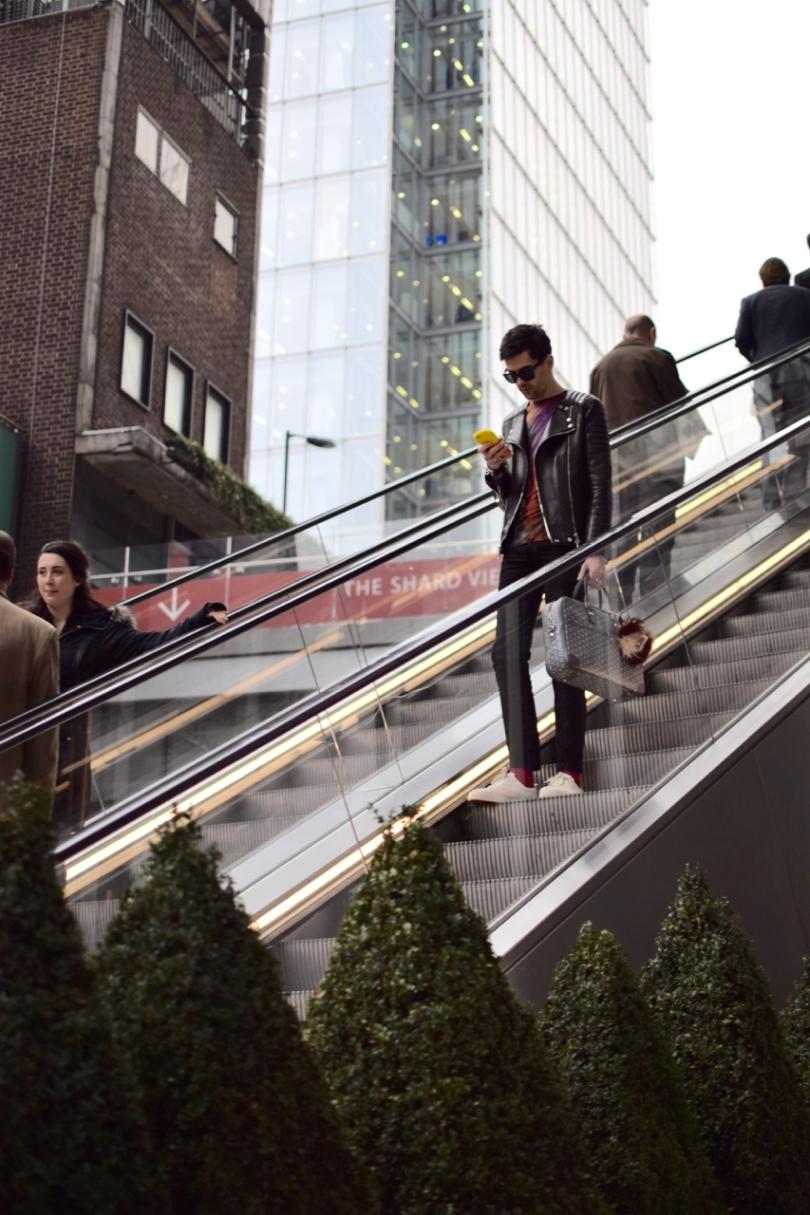 descending an escalator at London Bridge looking at my phone