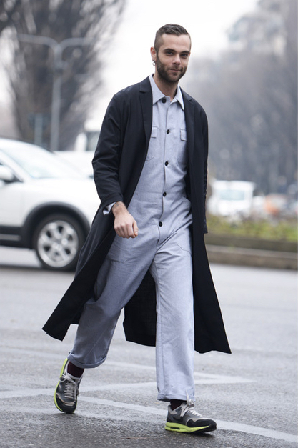 fashion journalist Simone Monguzzi wearing jumpsuit and long coat with nike sneakers