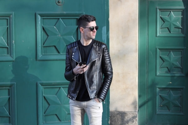 wearing black leather Balmain biker jacket and jeans outside Brighton Pavillion