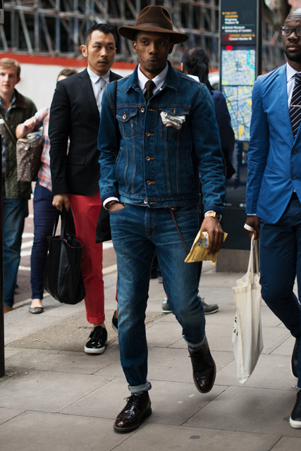 street style man looking slick wearing double denim with brown hat and pocket square
