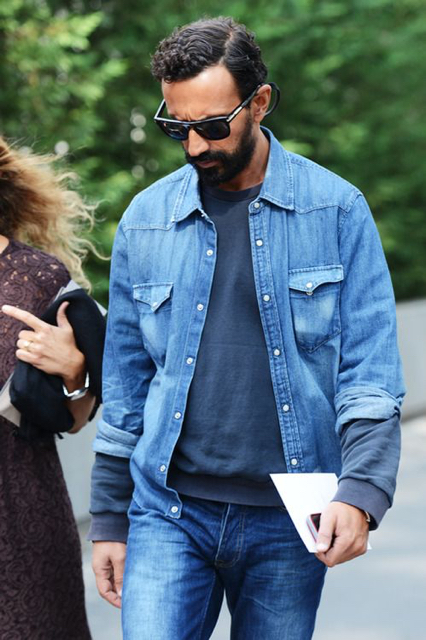street style shot of bearded man wearing double denim outfit