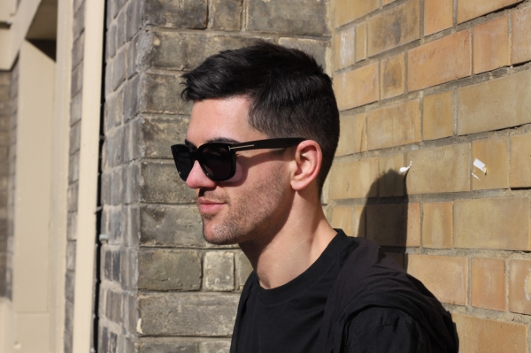 profile shot wearing all black outfit and Tom Ford Campbell sunglasses in Brighton