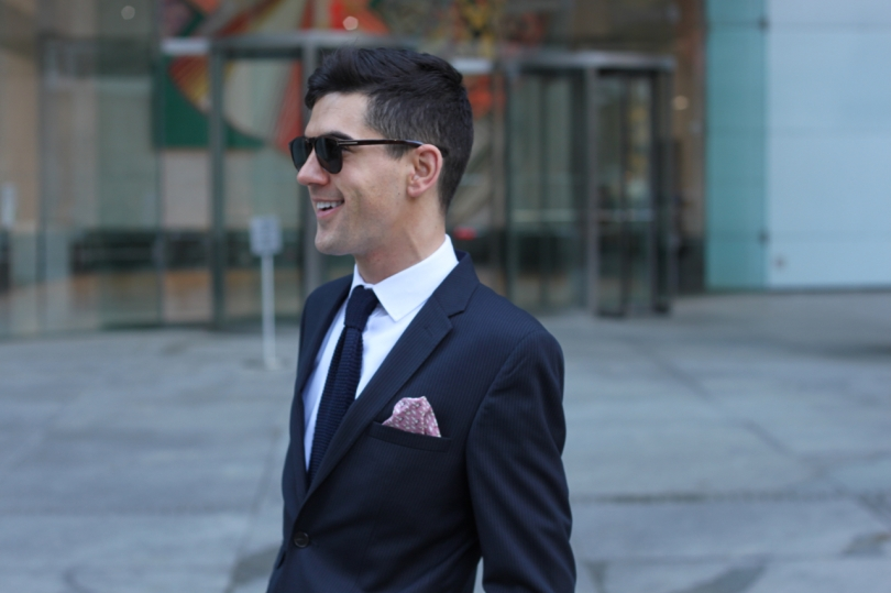 smart city look wearing slim fit suit white shirt knitted tie and pink silk Hermes pocket square
