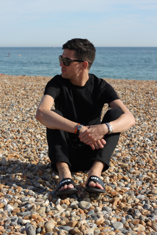 looking to the side on brighton pebbled beach in summer