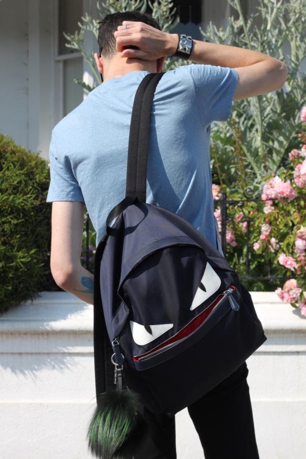 back view wearing navy Fendi monster eyes backpack